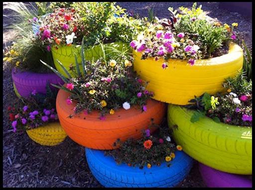 http://dizajn-sada.ru/wp-content/uploads/2012/10/tire-planter9999.jpg